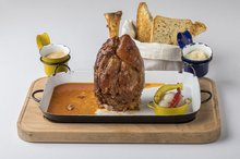 Grilled pork knuckle with mustard and apple horseradish, bread from our oven
